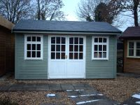 14x10 Orchard Room - painted willow cladding and white windows.