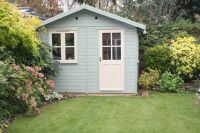 10x8 Summer Room with cream door and windows. Painted cuprinol shades willow.
