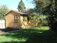 24 x 14 Studio with 2 doors in a double recess - Features garden office double glazed doors and windows and a felt tile roof