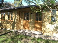 27 x 12 Studio style building, with a double recess, and garden office doors & windows. Internally fitted with a partition.