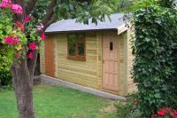 Garden building with a personal door, u-PVC window and a hardwood door. Featuring a partition to separate the shed area & grey felt tiles