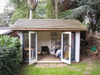 14 x 10 Orchard Room. Customer added Cedar Shingles, internal lining,  and Painted the building.