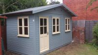 14 x 10 Summer Room with garden office D/G windows. Painted in Sky Grey Blue Protek, and Cream Windows.
