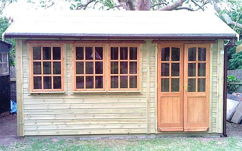 A Warwick Buildings Summer Room which features Georgian Style Double Doors & Windows. All Warwick Buildings can be pre-treated in a Protek Wood Treatment Colour prior to delivery. Visit