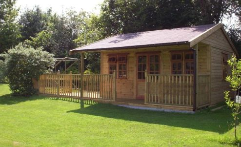 The Warwick Buildings Garden Pavilion with an extended decked area. A popular choice for a variety of uses such as a Barbecue or Pool Room, Playroom or  storage for garden furniture during the winter months